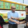"Globe/T. Rob Brown<br /> Misty Snodgrass, government relations director with the American Cancer Society, looks on from left, as Larry Warren, of Joplin, a small business owner, shakes hands with Jordan Overstreet, of Joplin, Monday afternoon during a ""Yes on Prop B"" bus tour stopover at Cunningham Park in Joplin."