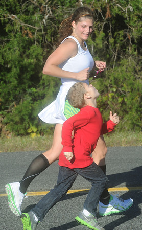 Globe/Roger Nomer<br /> Ty Bennett, 6, Sallisaw, Okla., runs alongside his mother Brandie for a stretch during the Mother Road Marathon on Sunday.