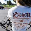 "Globe/T. Rob Brown<br /> Ruth Sawkins, of Joplin, sports a ""Look: Share the Road"" T-shirt Wednesday morning, Oct. 3, 2012, near the intersection of Murphy Boulevard and Campbell Parkway. Sawkins is part of the Look campaign and its Share the Road program, encouraging motorists to be more aware of bicyclists, runners and walkers."
