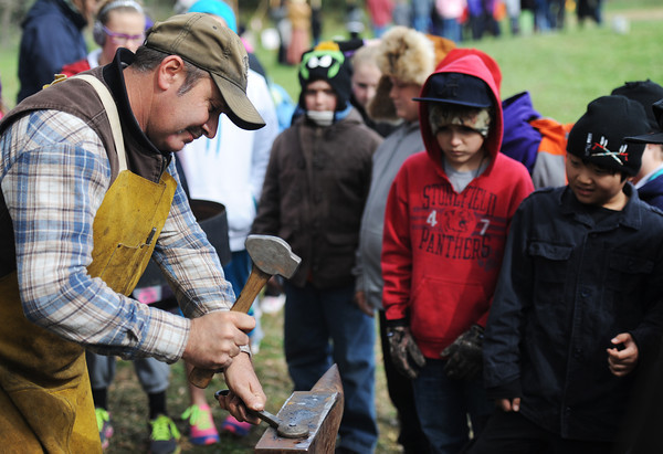 Globe/T. Rob Brown<br /> Blacksmith Troy Kukovich of Frontenac, Kan., forms the head of a Civil War-era style nail during a demonstration for Pittsburg, Kan., elementary school students Friday afternoon, Oct. 26, 2012, at Cato, Kan.