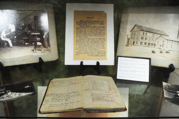 Globe/Roger Nomer<br /> Among the items on display at Pittsburg State's special collections are historic photos from the Appeal to Reason's building and JA Wayland's real estate ledger.
