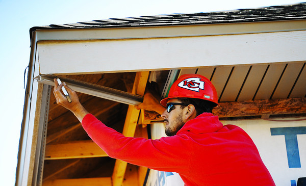 Globe/T. Rob Brown<br /> Korey Taylor, a carpenter with Extreme Exterior of Springfield, builds the soffit part of a large residential property on South Moffet Avenue, near 24th Street, Thursday afternoon, Oct. 18, 2012, in Joplin.