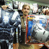 "Globe/T. Rob Brown<br /> Eric Myers holds up a children-sized Warmachine costume from the movie ""Iron Man 2"" Tuesday afternoon, Oct. 16, 2012, at Spirit Halloween store on North Range Line Road."