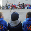 Globe/Roger Nomer<br /> (from left) Landon White, 8, Jayden Joseph, 4, and Carson White, 6, watch tumblers from The Flip Shop in the Maple Leaf Parade on Saturday.