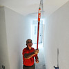 Globe/T. Rob Brown<br /> Bob Eley, of Wadsworth, Ohio, volunteer from First Christian Church Disciples of Christ through Rebuild Joplin, paints the ceiling of Tara Johnston's rebuilt Joplin home at 2021 S. Jackson Ave.