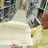 Globe/Roger Nomer<br /> Randy Roberts, curator of special collections at Pittsburg State, displays the front page of the Appeal to Reason dedicated to the death of JA Wayland in the PSU archives.