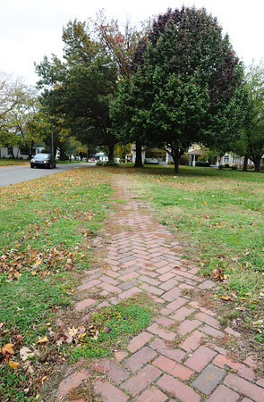 Globe/T. Rob Brown<br /> Part of the property at 17th and Locust, which the city of Pittsburg plans to develop, currently features an old brick sidewalk, as seen Friday afternoon, Oct. 19, 2012.