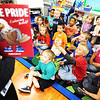 "Globe/T. Rob Brown<br /> Students in Nancy Thompson's kindergarten class are each presented with a copy of the ""Eagle Pride Coloring Book!"" Wednesday afternoon, Oct. 3, 2012, at West Central Elementary School."