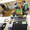Globe/T. Rob Brown<br /> Sue Jarvi, a tornado volunteer from Illinois, works on her office computer at a large warehouse Thursday morning, Oct. 18, 2012, in Joplin. The warehouse contains items for tornado victims and rebuilding efforts.
