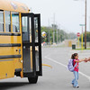 Globe/T. Rob Brown<br /> First grader Mariana Isabella De Leon, 6, who attends Cecil Floyd Elementary School, rushes to the arms of her father, Jose Cardoza, who waits for her at the bus stop in the FEMA mobile home park near the Joplin Regional Airport, Tuesday afternoon, Oct. 9, 2012. The family was displaced by the 2011 tornado.
