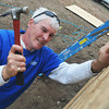 Globe/Roger Nomer<br /> Ken Rosberg hammers an exterior wall into place at 2630 Wall on Oct. 9, 2012.