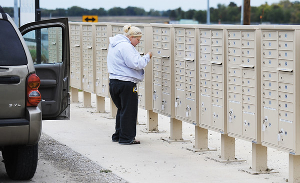 Globe/T. Rob Brown<br /> Brittany Simpson, of Joplin, checks the mail for her mother, Carla Simpson, who still lives in the FEMA mobile home park near the Joplin Regional Airport, Tuesday afternoon, Oct. 9, 2012.