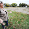 Globe/T. Rob Brown<br /> Deena Hallacy, community development specialist for the city of Pittsburg, Kan., looks around a property at 17th and Locust, which the city plans to develop, Friday afternoon, Oct. 19, 2012.