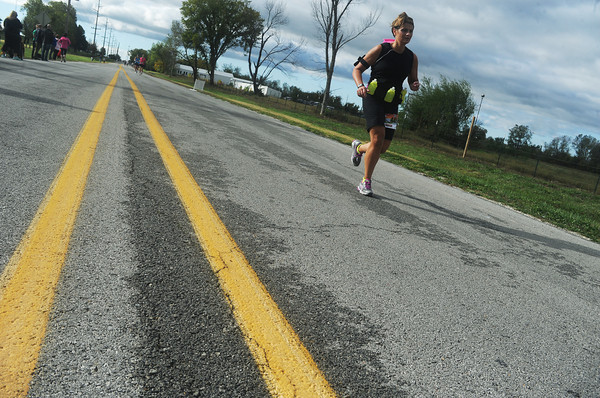 Globe/Roger Nomer<br /> Stacie Cooper runs down the home stretch of the half marathon at Sunday's Mother Road Marathon.
