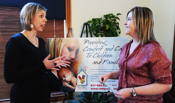 Globe/T. Rob Brown<br /> Tara Horinek, left, associate director of Ronald McDonald House Charities, talks to Rhiannon Edwards, director of marketing for Ashley Furniture HomeStore, as Edwards presents a donation of $1,360 to RMH Monday afternoon, Oct. 8, 2012, at RMH. The donation comes from HomeStore customers with matching funds from the store.
