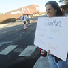 Globe/Roger Nomer<br /> Joy Delmont, Columbus, offers some encouragement to her daughter Heather Brahnin along Main Street in Galena on Sunday.