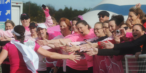 Globe/Roger Nomer<br /> Members of the Smokin' Hot Mamas Club cheer for one of their members as she crosses the finish line at the Joplin Athletic Complex during the Mother Road Marathon on Sunday.