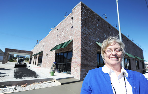 Globe/T. Rob Brown<br /> Dr. Cynthia Croy, owner of a new office building on South Main Street at 28th Street, which includes her doctor offices, stands in front of the building as construction nears completion in the background Thursday afternoon, Oct. 18, 2012.