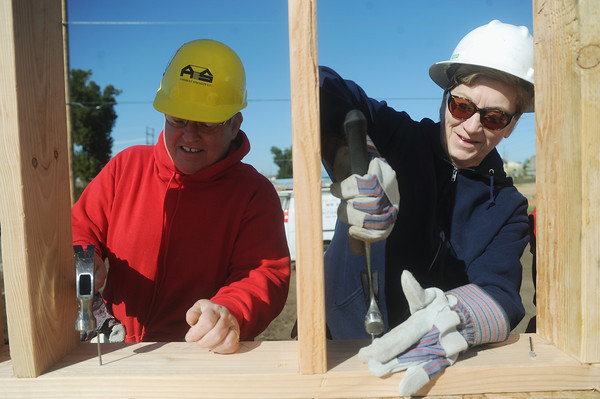Globe/Roger Nomer<br /> Linda Heman, a deputy clerk with Judge Crane, left, and Christine Beydler, a volunteer from Stott City, secure a wall at the 2630 Wall habitat site on Monday, Oct. 8, 2012.