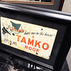 "Globe/T. Rob Brown<br /> A historic sign that reads, ""'Have one on the house' a TAMKO roof,"" on display at TAMKO's downtown Joplin office."