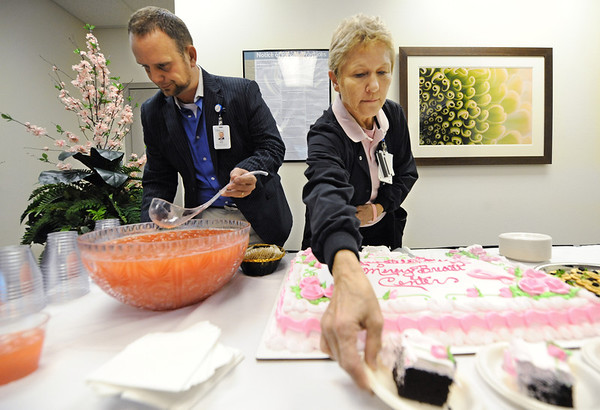 Globe/T. Rob Brown<br /> Cake and punch during the grand opening celebration for Mercy Breast Center Friday afternoon, Oct. 5, 2012.