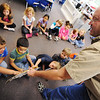 Globe/T. Rob Brown<br /> Jeff Cantrell, naturalist and conservation outreach and eduation with the Missouri Department of Conservation, holds out an owl wing and feathers for students to feel Tuesday morning, Oct. 2, 2012, during an owl presentation in Dana Shadwick's kindergarten class at West Central Elementary School in Joplin. Cantrell taught the students the differences between the great horned owl and a bard owl, as well as many interesting facts about owls in general.