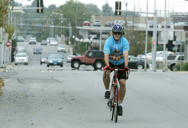 Globe/Roger Nomer<br /> Mark Morris rides his bike south on Joplin Street on Wednesday afternoon.