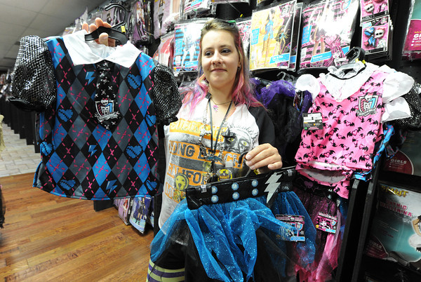 Globe/T. Rob Brown<br /> Jessica Myers looks at some of the children's Monster High costume offerings Tuesday afternoon, Oct. 16, 2012, at Spirit Halloween store on North Range Line Road.