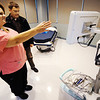 Globe/T. Rob Brown<br /> Jeanette Dunlap, tour guide and mammography tech coordinator for the Mercy Breast Center, shows Brad Baker, of Webb City, the new facility Friday afternoon, Oct. 5, 2012.