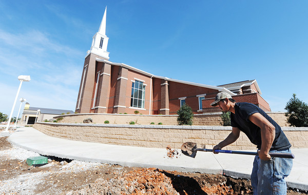 Globe/T. Rob Brown<br /> Teofilo Gonzalez, a laborer with Legacy Landscape & Excavation, installs and irrigation system Monday afternoon, Oct. 15, 2012, at the Church of Jesus Christ of Latter Day Saints (LDS) in Joplin. The church was destroyed during the May 22, 2011, tornado.