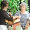 Globe/T. Rob Brown<br /> Lenore Pruit, left, nuitrition program assistant with the Area Agency on Aging, reads information as she is presented a quilt by Anne Barker, community service project chairman with the Town & Country Quilters during the organization's presentation of about 150 quilts to area charitable organizations held at First Presbyterian Church in Joplin Tuesday afternoon, Oct. 16, 2012. Quilt recipients included: Area Agency on Aging, Children's Center, Children's Haven, Freeman NICU, Lafeyette House and Life Choices. In addition to the quilts, the group also donated about 50 premie hats, 75 burp pads and 75 receiving blankets for the NICU plus about 200 placemats for Meals on Wheels.