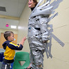 A Boone Meadow student places a piece of duct tape on Principal Kris Cavolick. Cavolick agreed to be duct taped to a wall after her students raised $10,500 for Jog-A-Thon. Cavolick said the money raised from Jog-A-Thon will help purchase classroom munipulatives such as books, technical support for students and other instructional materials.