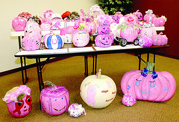 "Employees of NorthwestRadiologyNetwork, 96th Street and Zionsville Road, decorated 42 pink pumpkins in support of Breast Cancer Awareness Month. The pumpkins were judged, and five winners were named. Winners recieved a Yankee candle with a Halloween topper, and the decorated pumpkins will be used to adorn the tops of office cubicles during October. It's the first year for the contest, whcih also took place at the company's other three locations. ""We just want to get the point across we support Breast Cancer Awareness Month,"" said Marketing Manager Debbie Lawrence."