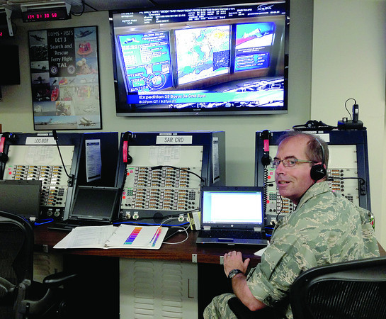 Lt. Colonel Scott Phillips, of Zionsville, monitors a Soyuz landing from his console, Sept. 11, at the Air Force Rescue Operations Center, Patrick Air Force Base, where he was in communication with Johnson Space Center in Houston, a rescue team at Ramstein Air Base in Germany, and recovery forces in Kazakhstan, where the astronauts landed safely.