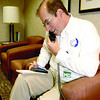 Dr. Scott Phillips of Zionsville answers a page recently at St. Vincent Hospital.