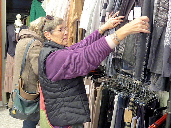 Debbie Oatis searches through clothing Friday afternoon, Oct. 18, at Delaney's. Delaney's held its grand opening Friday at their Zionsville location.