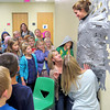 Tosha Herr checks to make sure Boone Meadow Principal Kris Cavolick doesn't fall after the principal was duct taped to a wall. Three rolls of duct tape were used to secure Cavolick to the wall. Students were able to duct tape their principal to the wall after meeting their goal of raising $10,500 for Jog-A-Thon.