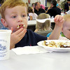 Cooper Barron, 3, bites off more than he can chew Saturday morning, Oct. 5, during the Zionsville Fire Department Pancake Breakfast.
