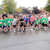 Members of the Eagle Elementary Running Club and other entrants for the Zionsville Optimist Club Hit the Bricks run get set Saturday morning, Oct. 5. Over 31 years, the annual race has raised more than $250,000 for local youth scholarships.