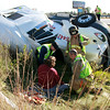 Rod Rose The Lebanon Reporter<br /> CRASH CLOGS INTERSTATE: Firefighters and paramedics attend to Gary Holman, 54, Cabool, Missouri, about 4:30 p.m. Friday after his semi-tractor-trailer overturned in a ditch on Interstate 65 about four miles south of Lebanon. Holman told police he fell asleep. The truck was loaded with 30,000 pounds of tires. Holman sustained a head laceration and complained of general pain. He was taken to Witham Hospital, Lebanon, for treatment. Units from the Lebanon, Whitestown and Zionsville fire departments, Boone County Sheriff's Office, Lebanon Police, Indiana State Police and Boone County EMS responded. Traffic north bound on I-65 was restricted to the two far left-hand lanes for several hours.