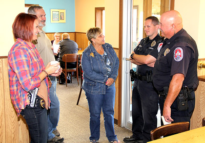 "'Coffee with a Cop' lands at Titus By Jake Thompson GOOD CONVERSATION: Julie Noland (center), of Lebanon, talks to Lebanon Police Officers (on right, from left) Jason Morgan and Cary Clanton as (from left) LPD Det. Amy Dickerson and Lebanon resident Steve Rose join the discussion. The event lasted from 9 to 10:30 a.m. on Thursday Morning at Titus Bakery. Citizens were encouraged to attend to get to know their local police officers, and bring any concerns or items of discussion. ""We've fielded some great ideas this morning,"" said LPD Chief Tyson Warmoth. ""We've had lots of compliments."" Warmoth hopes to hold the event three or four times a year so citizens may become more familiar with the officers."