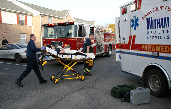 Rod Rose The Lebanon Reporter<br /> STABBING VICTIM: Boone County EMS paramedics wheel stabbing victim David Venis, 42, to an ambulance at the Canterbury Place Apartments on Lebanon's south side, late Friday afternoon.