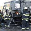 "Interstate conflagration<br /> Rod Rose The Lebanon Reporter<br /> HOT SPOTS: Firefighters quench a hot spot in the rear of an International Prostar semi-tractor that caught fire at the southbound rest park on Interstate 65 in northern Boone County about 4 p.m. Monday. Witness Michelle Dawson said that the truck's driver, whose identity was not immediately available, had just walked away from the vehicle when, ""All I saw was poof, and flames were coming out the back of the truck."" The tractor was destroyed; the contents of the trailer sustained smoke damage."