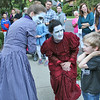 GHOSTLY ENCOUNTER<br /> Elizabeth Pearl | The Lebanon Reporter<br /> SPIRITS OF ZIONSVILLE: Carver Pank, 4, of Zionsville, tries to protect his hair from the ghosts of the Beck sisters, who wove a wreath out of the hair of Zionsville residents in the 1890s. The Beck ghosts were part of Zionsville's annual SullivanMunce Cultural Center Ghost Walk, which took place Friday evening and will start again tonight at 6:30 p.m. Tours start at the SullivanMunce center, 225 W. Hawthorne St., every 15 minutes.