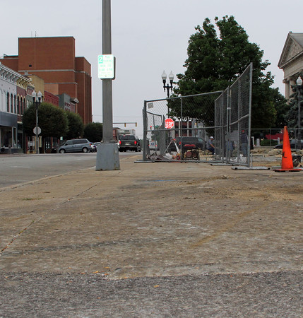 REPAIR ZONE: The sidewalk will be repaired from this point down to the corner where the stamped concrete begins.