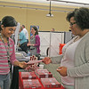 LHS HOSTS CAREER AND COLLEGE FAIR<br /> Elizabeth Pearl | The Lebanon Reporter<br /> PLANNING FOR THE FUTURE: Lebanon Middle School sixth-grader Martina Bustos, left, picks up a pamphlet from Khala Granville, associate director of admissions at Indiana University, Tuesday evening at a College and Career Fair at Lebanon High School. Bustos wants to attend IU and study teaching, she said. Her mother, Natalie Bustos, said that her daughter already has plans to rent an apartment in Bloomington with one of her friends. <br /> This was the second year LHS has hosted the event. More than 75 businesses and colleges had booths this year, and more than 250 students pre-registered for the event.