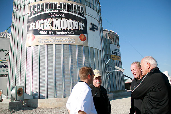 Rod Rose The Lebanon Reporter HOME TOWN HERO: Rick Mount talks with Elliot Bloom (left), Dean Jackson (second from left) and Don Jackson Tuesday morning as they, Purdue University represenatives, family and friends attend the official debut of a sign commemorating Mount's basketball career.