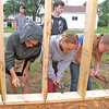 Photo submitted<br /> HAMMER TIME: Three of the several dozen women participating in Habitat for Humanity of Boone County's third annual Women Build assemble a wall for a home under construction on Evans Street in Lebanon.