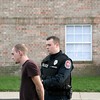 Rod Rose The Lebanon Reporter<br /> STABBING SUSPECT: Lebanon Police Officer Josh Walker places handcuffs on Brandon Conner, 22, after Conner was found in a ground-floor apartment at the entrance to Canterbury Apartments on Lebanon's south side. Police believe Conner stabbed a man at another apartment.