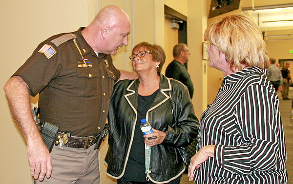 Rod Rose The Lebanon Reporter<br /> CONGRATULATIONS: Jane Taylor and Debbie Ottinger congratulate Sheriff MIke Nielsen Tuesday night after the Boone County Tax Council unanimously approved a .5 percent increase in the county's local income tax rate.